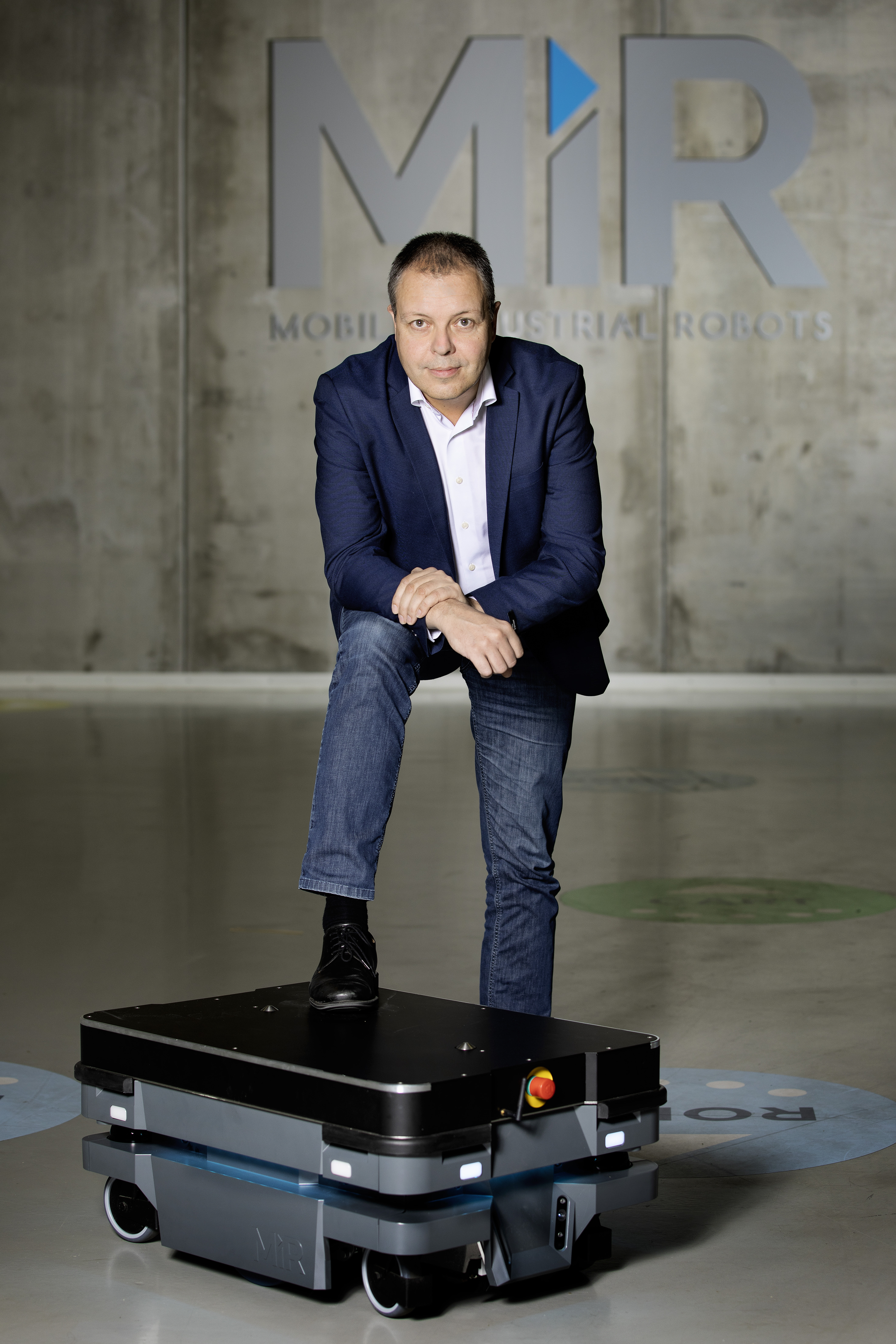 Søren Nielsen, MiR CEO, surrounded by the autonomous robots manufactured by Mobile Industrial Robots.